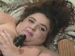chunky-and-lustful-lady-has-a-black-toy-making-her-tight-cunt-all-wet