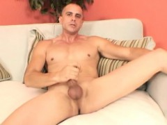 handsome-guy-sits-naked-on-the-couch-and-slowly-pleases-his-long-pole