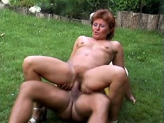 Naughty mature woman has a stiff cock drilling her holes in the garden