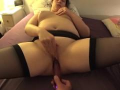 chubby-brunette-in-black-stockings-spreads-her-legs-in-bed