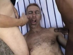 Charming Guy Has Two Hung Studs Filling His Mouth With Their Juices