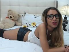 nerdy-blonde-girl-in-black-stockings-spreads-her-body-acros