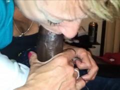 mature-beauty-blowing-a-black-shaft