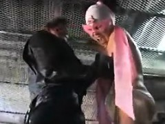 busty-super-hero-babe-is-tortured-on-the-floor-with-a-wicke
