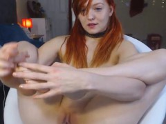 pretty-redhead-displays-her-nice-pink-pussy