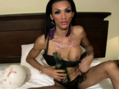 skinny-black-hair-ts-fucks-tight-anal-with-champagne-bottle