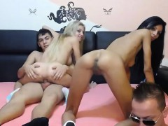 brunette-and-blonde-having-group-sex-in-the-living-room