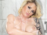 Busty blonde Daisy Monroe toys her wet pussy