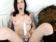horny-tattooed-brunette-on-webcam-working-with-hitachi