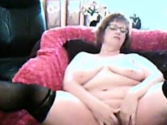 busty-mature-in-stockings-masturbates-pussy-on-webcam