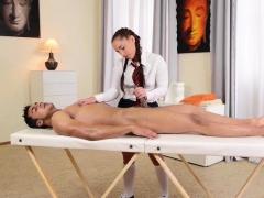 brunette-schoolgirl-massages-a-big-dick