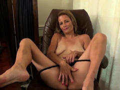 american-milf-lucky-has-lots-of-fun-with-a-red-dildo