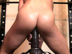 female muscle porn star rides a monster dildo