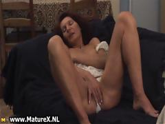 horny-mature-woman-squeezes-part3