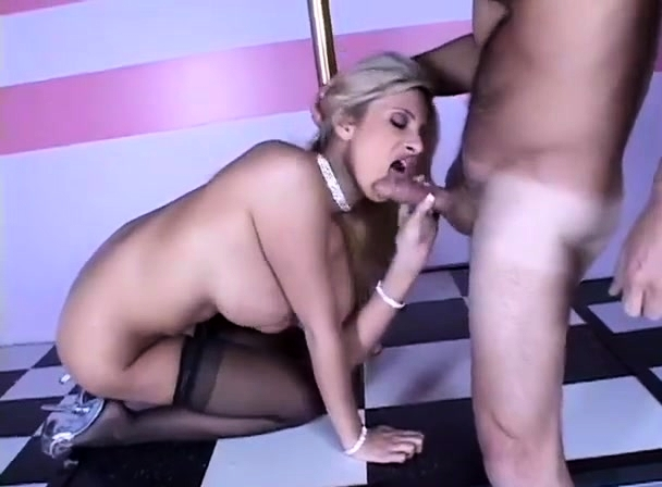 Busty blonde MILF in black stockings riding cock on couch