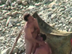 guys-sucking-on-the-beach