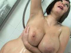 Roxy Anderson Soaps Up Her Giant Tits And Round Ass