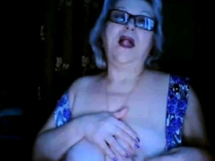 russian-granny-ex-teacher-flashing-her-big-tits-on-webcam