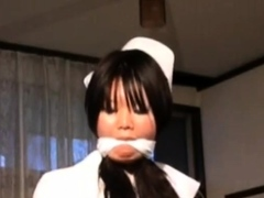 Girl in fetish uniform uses strapon to fuck her BF