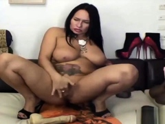 bbw mature shoves toys in her ass