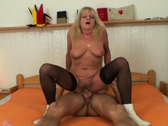 very-old-blonde-in-stockings-rides-stranger-s-cock