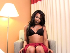 Transsexual black beauty plays with her cock
