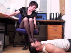 mature Mistress and her foot smelling slave in home office