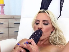 Oiled Up Milf Stretches Her Pussy With Monster Dildo