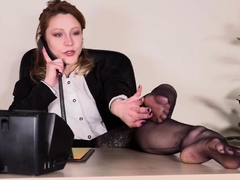 Secretary in stockings shows off feet