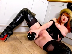 Red XXX masturbates and stuffs her pussy in the kitchen