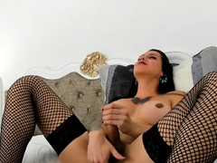 Big tit shemale jerks her long cock